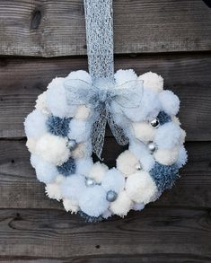 Beautiful bespoke woollen Pom-Pom wreath, classic silver, white and cream in colour, complete with miniature baubles and hanging ribbon. Ideal for hanging indoors and under porch cover. Approx 16 (Please note; white pom-poms show as pale blue in photo image, these are white)