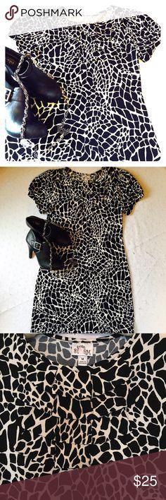 "Sweet Storm dress Sweet Storm dress. Size M. NWOT. black/cream. Armpit to armpit 18"". Shoulder to bottom hem 34"". Boutique Dresses"