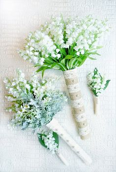 Lilly of the valley Wedding Bouquet Set - Here is a one of a kind Lily of the Valley wedding bouquet package!  This is a very natural arrangement that is also chic and modern.   The bridesmaid's bouquet has Baby Freesia and green foliage in addition to the Lily of the Valley bringing harmony to the bride's bouquet.