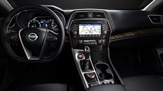 2016 Nissan Maxima Platinum interior, shown in charcoal leather