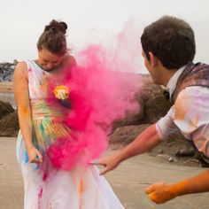 bride and groom on the beach with paint