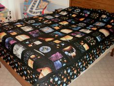 2011 - Space quilt for Tony. (At the time of the picture, it had just been quilted and was awaiting binding.)
