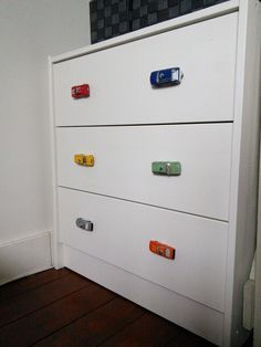 My diy, i replaced the boring knobs with toy cars for our toddler boy!