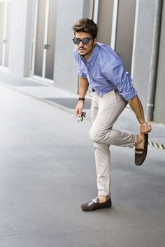 To create an outfit for lunch with friends at the weekend pair a light blue gingham button-down shirt with beige chinos. Round off this look with dark brown leather moccasins.   Shop this look on Lookastic: https://lookastic.com/men/looks/light-blue-gingham-long-sleeve-shirt-beige-chinos-dark-brown-leather-driving-shoes/18775   — Light Blue Gingham Long Sleeve Shirt  — Beige Chinos  — Dark Brown Leather Driving Shoes