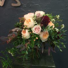 Striking Bridal bouquet with Amnesia, Sweet Avalanche&Peach Juliet roses, dahlias, hypericum berries, succulent, wax flowers, plumosa.