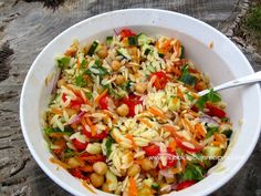 Orzo with Tomatoes, Chickpeas, Cucumber, Carrot, Red Onion, Feta and Herbs. Dressing with lemon, lime and olive oil.