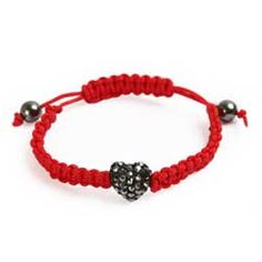Made with a heart shaped Shamballa Style Bead. You can learn how to make @Laura Bajor's Heart bracelet by clicking on the picture and learning how to do macrame knots.