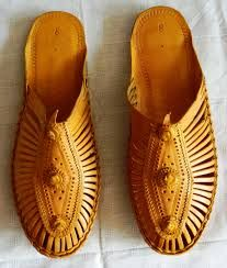 Kolhapuri chappals are Indian hand-crafted leather slippers that are locally tanned using vegetable dyes. Kolhapuri Chappals or Kolhapuris as they are commonly referred to are a style of open-toed, T-strap sandal which originated from Kolhapur, a southern district in the state of Maharashtra.