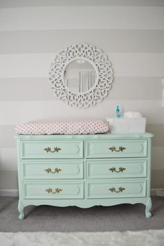 Coral Medallion changing pad sheet on a pale mint dresser
