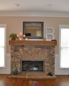 After: Stacked stone, reclaimed wood from a 1800's barn, neutral walls, wide plank wood floor