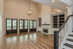 Open concept and high ceiling. Like how kitchen integrates into fam room with vaulted ceiling. Kitchen still feels big.
