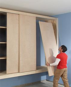 Awesome garage storage plans using old doors - to lock up the things we don't want the little one to get into...