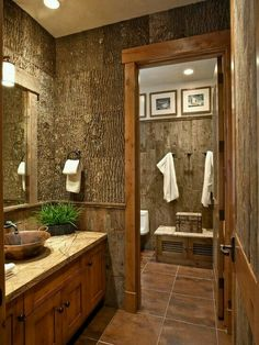 Wow. Now this is an awesome rustic master bath. Trimmed with recycled barn wood, job site lumber leftovers, and tree bark.