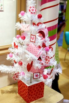 Pink, red, and white valentine tree! Maybe even buy a box of valentine cards to put in the tree!