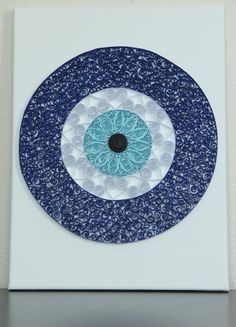Unique handmade quilled art Evil Eye home and wall decoration. It is made of hand-cut paper strips and glued to the art canvas, size 9 x 12. Evil eye piece is about 8 in diameter. This art piece is not waterproof nor fireproof.  All items in our shop are made in a non-smoking and pet free environment!  For International - please message us for shipping quote.  Thank you for shopping at Creatix Studio store