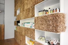 Hornowski design fills cosmetics boutique with straw bales,..Strong ecological focus displaying the natural products on sale.