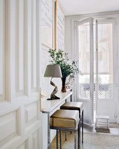 all white entry way
