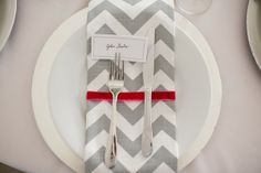 Really like Chevron pattern and grey and white- the touch of red is perfect (pink & yellow would work nicely as well)