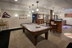 Play some pool, chat with friends, or watch your favorite team play in this finished basement. (Toll Brothers Weatherstone of Avon, CT)