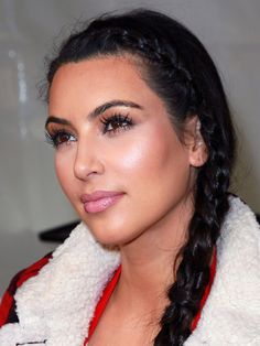 """CREATE CONTOURS  Kardashian has a technique she swears by. She described it to us: """"I put on all my foundation first. I powder my face, then I put on concealer...and blend it with a pink egglike sponge, the BeautyBlender. Then I contour all here—think of a three."""" [Using her finger, she draws an invisible three on each side of her face.] """"I go cheekbones, under chin, then the top. I love Smashbox Bronze Lights in Suntan Matte because it doesn't have sparkle in it."""""""