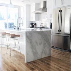 Kitchen, white cabinets, waterfall island