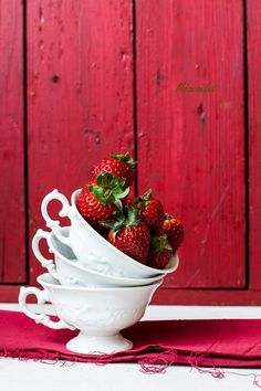 Strawberries and white cups