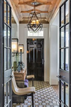 Love the doors, traditional but modern, the ceiling detail, the floor tile - Transitional White Entry Hallway with Black Door Design Entrée, House Design, Lobby Design, Design Table, Chair Design, Home Interior, Interior Design, Design Interiors, Interior Architecture