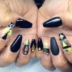 Lime green and black negative space nails with gold bling.