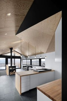 Minimalist Kitchen // geometric wood ceiling and counter tops in this clean modern kitchen designed by naturehumaine. The Bolton Residence, a house on a sloped site surrounded by woodlands in Quebec, Canada. Modern Interior Design, Interior Design Kitchen, Interior And Exterior, Design Interiors, Kitchen Decor, Contemporary Design, Kitchen Pantry, Kitchen Ideas, Interior Decorating