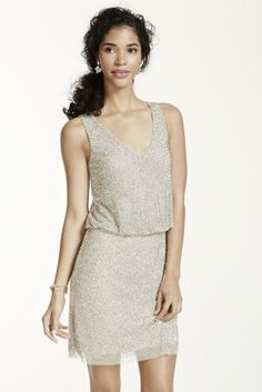 Sparkle from head to toe is this glamorous caviar beaded blouson dress!  Sleeveless V-neck bodice features all over stunning caviar beaded accents.  Blouson detail helps shape a flattering silhouette.  Fully lined. Imported polyester. Professional spot clean only.