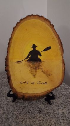 Life is good! Woodburned wood slice with canoe and sunset.