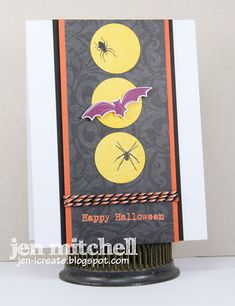 handmade Halloween card from I Create ... luv the clean graphic look ... center panel running top to bottom with double mat and wide border ... gray background with three circles (full moons?) topped with a spider or bat ... like the orange and black baker's twine wrap ...