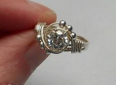 Faceted Gemstone Settings Tutorials Including this Easy Beaded Solitaire Ring - A wire wrap tutorial [More on Site... http://www.brandywinejewelrysupply.com/blog/faceted-gemstone-tutorials/]
