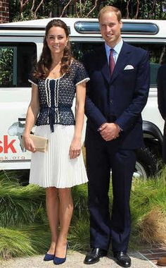 Coordinating Ensembles from Kate Middleton's Best Looks  The royal couple poses with pride in their matching navy blue outfits. Kate keeps it simple with a white pleated skirt, knitted blouse, navy blue shoes and—any girl's dream accessory—her own prince!