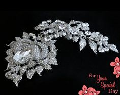 What an amazing large and long floral bridal broach with such sparkle! Made of grade A+ crystal rhinestones that catch the light at every angle. Would be an elegant hair piece or attached to the back of your dress.  by ForYourSpecialDay, $52.99