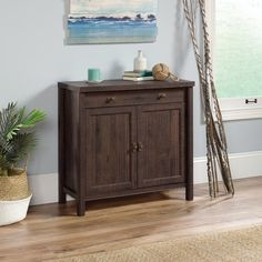 Sauder Woodworking 422981 Costa Inch Wide Ready-To-Assemble Cabinet with Coffee Oak Indoor Furniture Storage Cabinet Hidden Shelf, Hidden Storage, Ready To Assemble Cabinets, Sauder Woodworking, Door Storage, Storage Cabinets, Wooden Tops, Cabinet Colors, Panel Doors