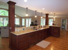Kitchen Island With Columns view of kitchen from stairs | open kitchens, kitchens and columns