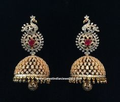 Grand classic diamond jhumkas with a lovely bell shaped jhumka hanging with a diamond studded ball in the middle. The diamond jhumkas are headed with a peacock design Diamond Jumkas, Diamond Studs, Diamond Pendant, Diamond Jewelry, Gold Jewelry, Diamond Earrings, Diamond Necklaces, Gold Necklaces, Gold Bangles