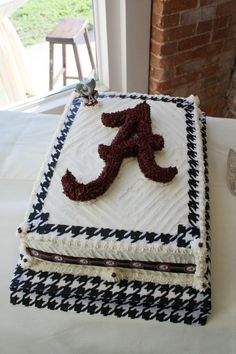 Alabama Groom's Cake,  made this for my son's wedding.  Super simple to make.  Using a A silicone cake pan and houndstooth ribbon.
