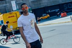 loving the bright sunglasses and metallic detailing on his crisp white shirt, menswear street style in New York