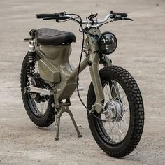The eCub 2 is a retro electric motorcycle from the international team at Shanghai Customs, it combines the much loved Honda Super Cub chassis with an . Honda Cub, Retro Motorcycle, Motorcycle Bike, Bobber Custom, Custom Bikes, Electric Moped, Electric Cars, Honda Motorbikes, Cb 500