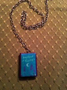 Mini Book Necklaces: Breakfast at Tiffany's by Truman Capote Mini Book Jewelry by GidgetsTreasures on Etsy #breakfastattiffanys #trumancapote #minibookjewelry #minibooks #bookcharms #booknecklaces