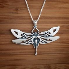 This sterling silver dragonfly pendant is a stylized design with wide detailed wings being crafted with delicate celtic knotwork. Fairy Jewelry, Dragonfly Necklace, Dragonfly Pendant, Sea Glass Jewelry, Pendant Jewelry, Pendant Necklace, Necklace Chain, Silver Necklaces, Sterling Silver Pendants