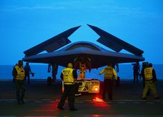 (May 13, 2013) An X-47B Unmanned Combat Air System (UCAS) demonstrator is towed into the hangar bay of the aircraft carrier USS George H.W. Bush (CVN 77).