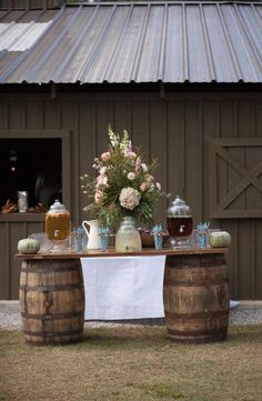 Drink table bade from old barrels and a board. Rustic and beautiful.