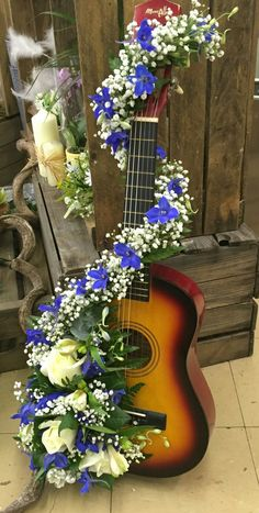 Floral tribute made onto a guitar Floral tribute made onto a gu. Casket Flowers, Funeral Flowers, Grave Decorations, Flower Decorations, Funeral Floral Arrangements, Flower Arrangements, Funeral Sprays, Casket Sprays, Funeral Tributes