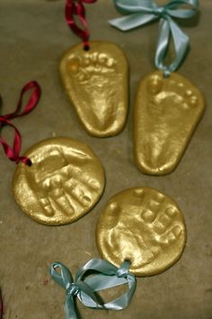 Handprint Ornaments = Salt Dough (1 cup salt/2 cups flour/cold water to consistency) + baby hands (or feet) + Martha Stewart Gold Acrylic Craft Paint + Ribbon.  I recommend chilling the dough in the fridge before doing the handprint.  Bake in the oven at 250 degrees or until hard.  I also recommend applying the paint with your finger as it seems like the brush disrupts the dough's surface.
