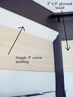 "cut down a sheet of 1/4"" plywood to window width size; nail above existing molding; add 3"" crown molding; fill gaps with picture molding; caulk; prime and paint"