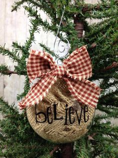 rustic ornament filled with burlap and with a plaid bow