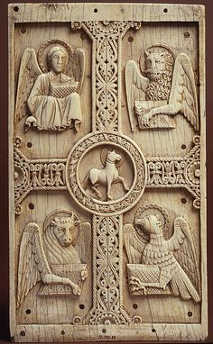 Plaque with Agnus Dei on a Cross between Emblems of the Four Evangelists, 1000–1050 German or North Italian. Ivory.
